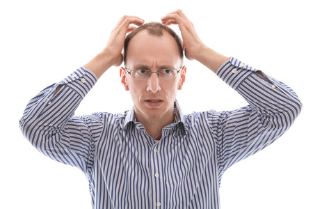Sad and shocked bald isolated man in blue shirt over white background.