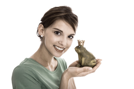 smiling frog: Story of frog king - young isolated woman. Concept for singles, wedding or valentines day.
