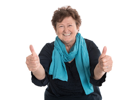 Enthusiastic and happy funny grandmother making thumbs up gesture with two fingers. Stock Photo