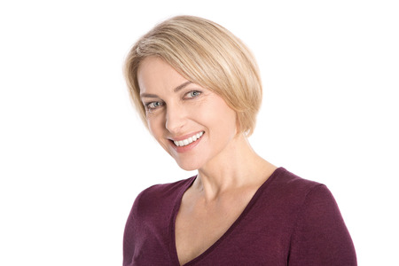40s: Portrait  isolated face of a smiling attractive middle aged blond woman  Stock Photo