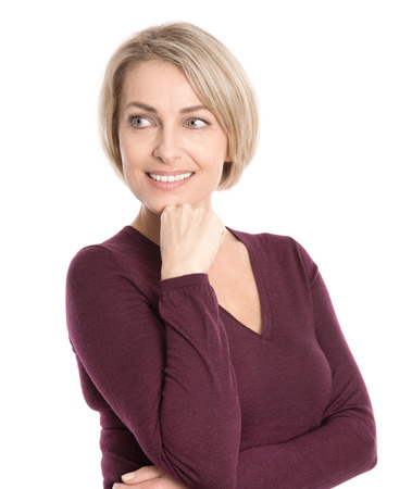 sideways glance: Isolated smiling middle aged woman in fall clothes looking sideways to text  Stock Photo