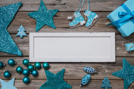 Merry christmas card in white and turquoise colores with a wooden sign. photo