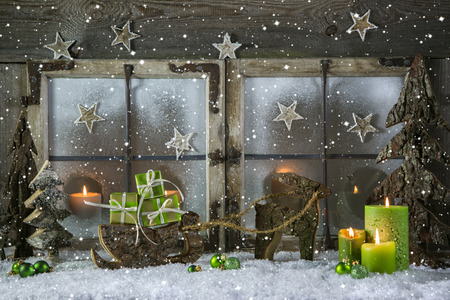 Natural wooden christmas decoration with candles and green gift boxes. photo