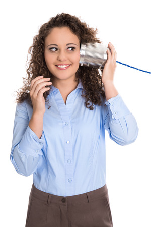 Pretty isolated young businesswoman on the tin can phone: communication concept.