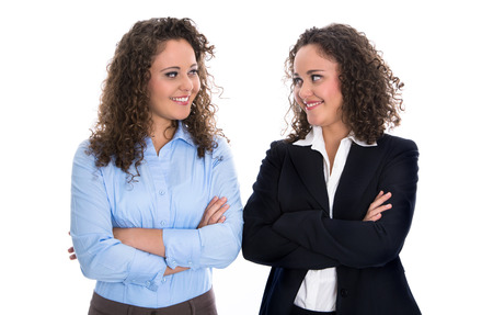 twins: Portrait of two young happy isolated businesswoman - real twins. Stock Photo