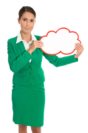 Isolated business woman in green holding a white and red placard in her hands. photo