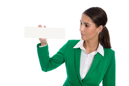 Isolated business woman holding white billboard in her hands wearing green suit. photo
