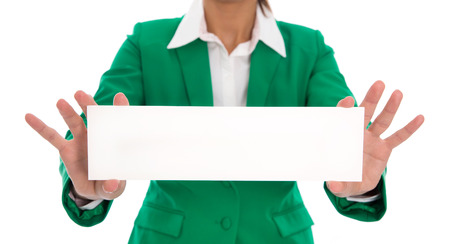 Isolated business woman hands holding white sign wearing green blazer. photo