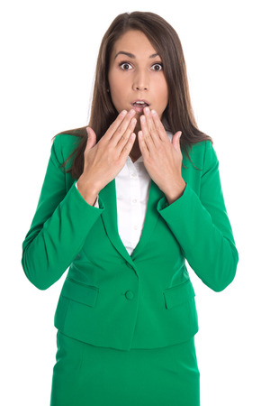 outraged: Shocked isolated business woman wearing green dress. Stock Photo