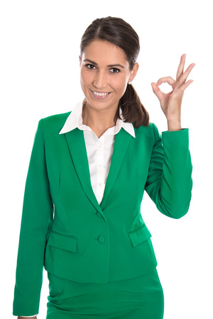 Isolated business woman in green making excellent gesture with fingers.