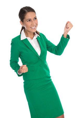 reached: Isolated smiling businesswoman in green celebrating her success.
