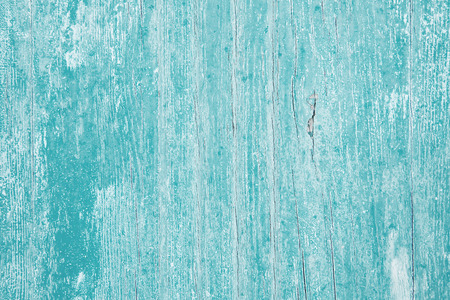 Surface of an old wooden painted background in turquoise color. Stock Photo