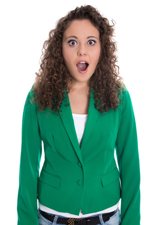 mimic: Portrait of an isolated shocked and surprised business woman in green blazer. Stock Photo