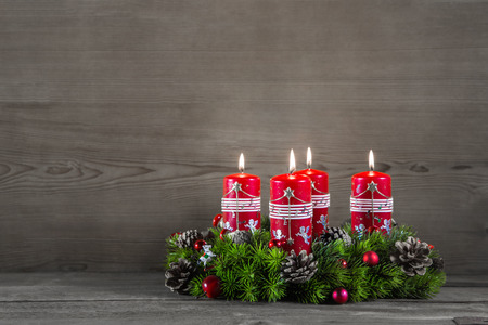 advent wreath: Advent wreath or crown with four red candles on wooden grey background.