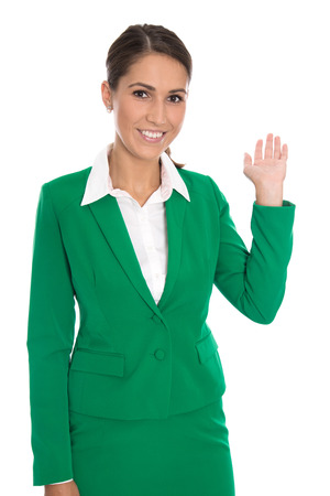special service agent: Isolated pretty smiling businesswoman in green showing something with her hands.