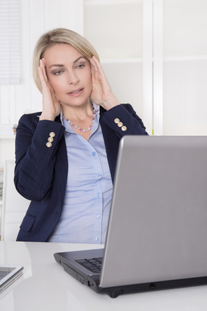 forgetfulness: Older business woman with problems and work also concept for dementia or forgetfulness.