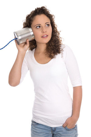 tin can phone: Isolated serious woman listening on tin can telephone for news or changes. Stock Photo