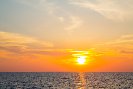 atmospheric: Sunset on the ocean with horizon for an atmospheric emotional background