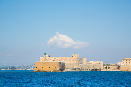 siracuse: Sightseeing. Castello Maniace at Siracuse in Sicilia: Ancient town Ortygia. Stock Photo