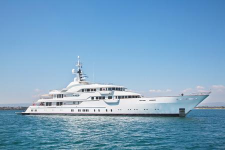 Luxury big motor yacht on the blue ocean.