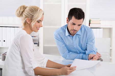 two people talking: Customer and client sitting at desk or business people talking about finance at work. Stock Photo