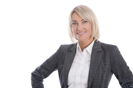 personalities: Portrait: Beautiful middle aged isolated businesswoman wearing costume and blouse. Stock Photo
