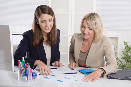 economists: Team of successful businesswoman in the office: concept for equal rights or woman in leading positions.