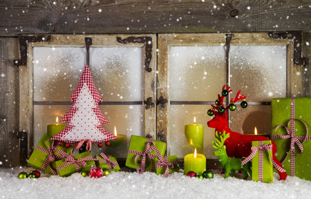 Christmas background or window decoration in red and green colors with candles. Idea for a xmas greeting card.