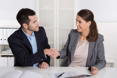 Business talk with handshake: counselor and customer or hello to a new colleague. photo