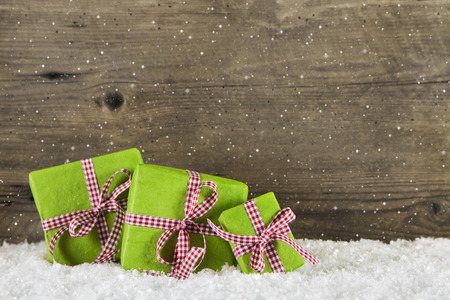 Apple green christmas presents on wooden background for a gift certificate or voucher. photo