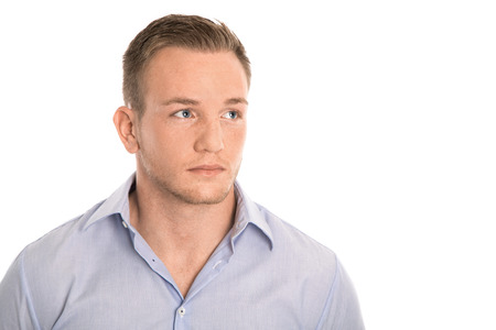 Portrait: isolated young thoughtful man in blue shirt and freckles.