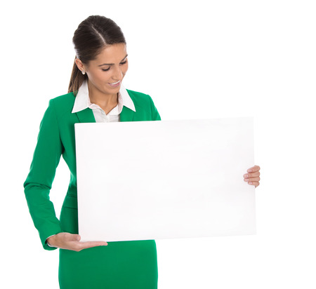Isolated professional business woman holding white sign or billboard in her hands wearing green blazer. photo