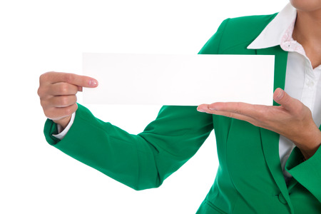 Businesswoman in green holding empty with billboard or sign in her hands. photo