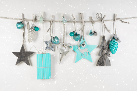 festive christmas decoration in white an light blue on wooden background stock photo 32837225