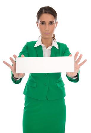 Serious isolated businesswoman in green holding message board in her hands. photo