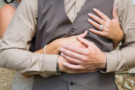 intimacy: Hands: lovers holding hands after wedding.
