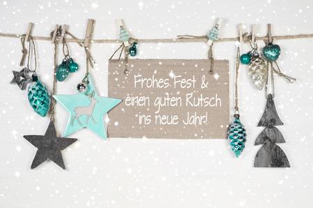 azul turqueza: Feliz tarjeta de Navidad en blanco, gris y de color turquesa y un feliz nuevo deseos: Tarjeta de Navidad con el alem�n texto. Foto de archivo