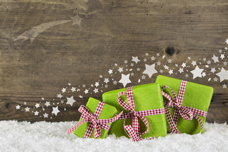 Green christmas presents on wooden background for a gift certificate or voucher. photo