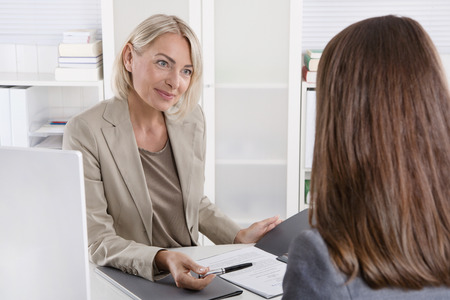 career counseling: Mature businesswoman in a job interview with a young woman. Stock Photo
