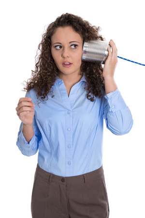 stunned: Isolated young business woman with tin can phone serious and stunned.