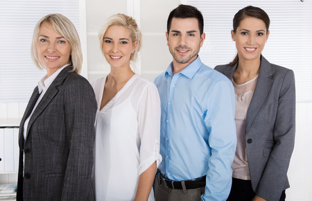 sucessful: Portrait: female boss with her staff. Sucessful teamwork. Stock Photo