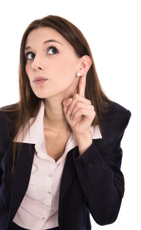 Nosy young woman listening on the door: concept for privacy and confidential things. Stock Photo