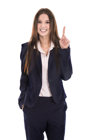 humorously: Funny young isolated businesswoman in suit showing something with her finger over white background.