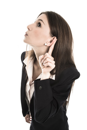 disadvantages: Nosy young woman listening on the door: concept for privacy and confidential things. Stock Photo