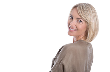 middle age women: Beautiful isolated blond smiling mature woman over white background.