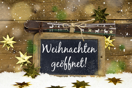 Advertising board for winter tourists: We have open on christmas holidays in german language. photo
