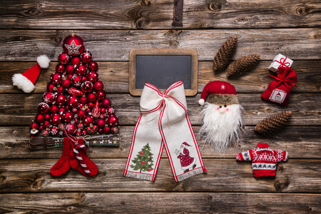 Festive natural christmas decoration: Red, white and wood with an empty sign for text. photo