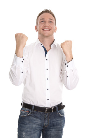 Successful and happy isolated young blond man making fist gesture with hands. photo