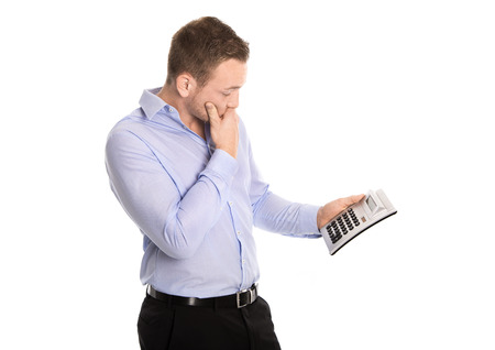 outgoings: Shocked and disappointed business man with pocket calculator about increased cost of living and outgoings.