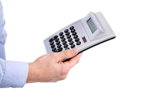 Isolated business man holding a pocket calculator in his hands wearing blue shirt.